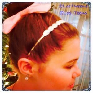 Easy bun with a bow and metal head band adds a festive flair
