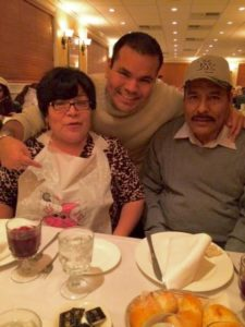 Dennis with his parents in New Jersey.