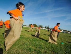 Youth from Boys & Girls Clubs of of Kern County participate in sack races during Boys & Girls Clubs of America and Nestle's National Fitness Competition in Bakersfield, California. (PRNewsFoto/Boys & Girls Clubs of America)