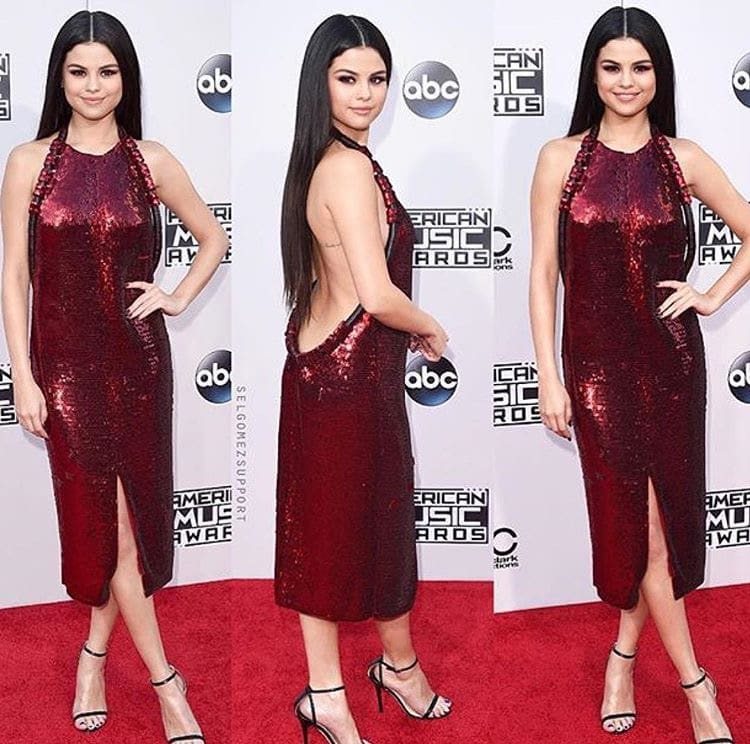 Selena Gomez looks like a shining ruby in an elegeant shining red dress with a surprised sexy back.