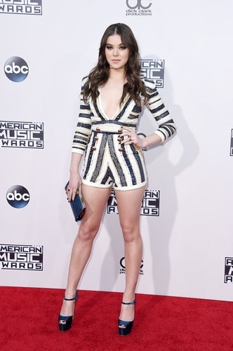 """Actreess-turned-pop star, Hailee Steinfeld, rocked this short body suite that showed off her gorg legs. When asked by E! News what she preferred to win: an Oscar or a Grammy AND and a AMA, a very wise Hailee said: """"What about a Grammy and AMA for a song that I won an Oscar for?"""" You go girl! Photo by: Getty Images"""