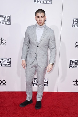 From brotherly boy bandmember to hunk soloist...Nick Jonas looks sharp in this all-grey ensemble. He performed a sampler of his top three songs of the year...and we loved it! Photo by: Getty Images