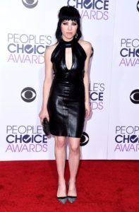 Singer Carly Rae Jepsen rocks a black leather short dress that goes with her rocker chic hairstyle.