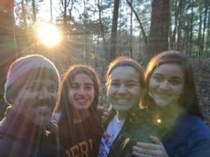 Fernando and his beautiful bicultural, bilingual teen daughters at sunrise camping