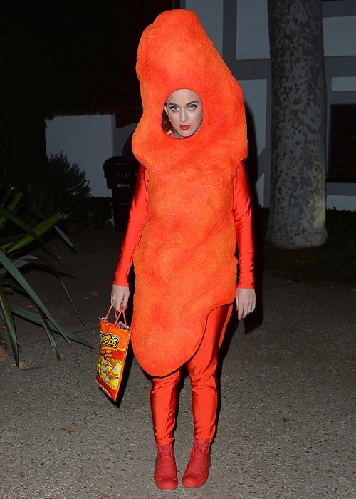 "Katy Perry is looking ""hot"" in her Hot Cheeto Puff Halloween costume in 2014. Photo credit: popinsomniacs.com"