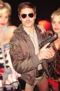 Zack Efron looking uber cool in his Reno 911 Halloween costume of 2012. Photo credit: addictedtoefron.tumblr.com