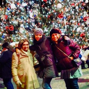 Me with grandma and mami in front of Bryant Parks Christmas Tree in NYC.