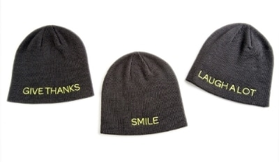 "The Giving Hat™ is a stylish winter knit hat, one-size-fits-all and available in three versions embroidered with messages inspired by St. Jude patients and their families: ""Smile,"" ""Laugh A Lot,"" and ""Give Thanks."""