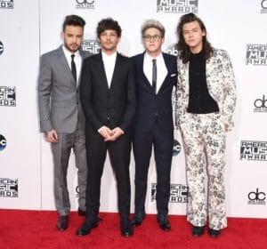 "The boyband ""One Direction"" wins Best Band for the third consecutive year. We specially like Harry's Gucci funky suit and pants. Photo by: Getty Images"