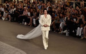 Kendall Jenner in Chanel in Paris Fashion Week - Haute Couture Fall/Winter 2015/2016. Photo credit: www.eonline.com