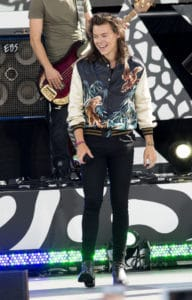 Harry performs in a bomber jacket from Saint Laurent's spring-summer 2016 menswear collection in ABC's Good Morning America in Central Park in 2015. Picture by: Mayer RCF /Splash News and Pictures