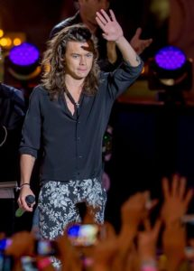 Harry performs with One Direction in the Jimmy Kimmel show wearing a black button-up shirt with black and white floral pants. Designer unknown. Photo by: Pacific Coast News /Barcroft Media