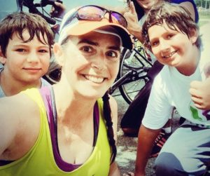 Cristina Ramirez with her two boys after completing a 20mile run. The boys joined her side and biked for the last 3 miles.